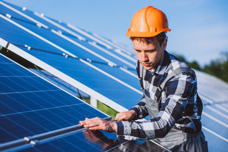 man-worker-in-the-firld-by-the-solar-panels-1-1-1